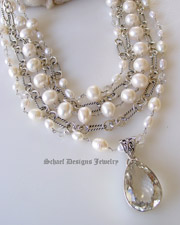 White pearls clear crystal quartz & sterling silver David Yurman style figaro chain 5 strand designer bib necklace with white druzy & opal cross pendant | Signature Collection | online upscale designer jewelry gallery boutique | Schaef Designs designer gemstone jewelry | Couture Signature Collection | San Diego, CA